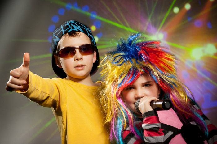 Little children singing, dancing in disco club