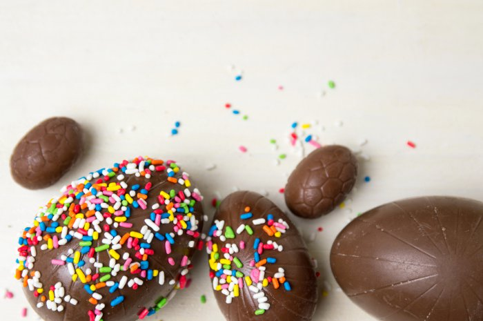 Chocolate eggs covered with colorful edible sprinkles